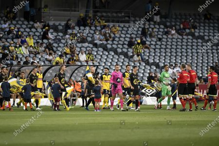 Graham Dorrans of Western Sydney Wanderers leads his team onto the pitch; Central Coast Stadium, Gosford, New South Wales, Australia; A League Football, Central Coast Mariners versus Western Sydney Wanderers.