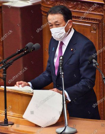 Stock Image of Japan's Deputy Prime Minister and Financial Minister Taro Aso wearing a face mask, delivers a financial speech during the Lower House's plenary session of the 204th Ordinary Diet session at the National Diet in Tokyo, Japan.