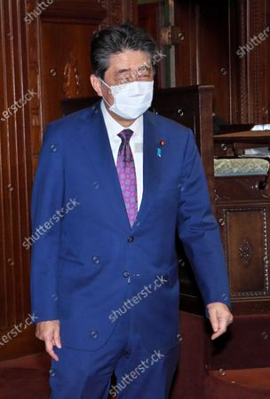Stock Picture of Former Japan's Prime Minister Shinzo Abe leaves after the Lower House's plenary session at the National Diet in Tokyo, Japan.