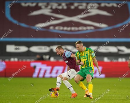 Vladimír Coufal of West Ham and Kamil Grosicki of West Bromwich Albion
