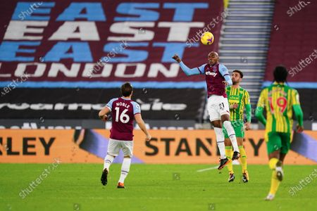 Angelo Ogbonna of West Ham United heads the ball clear
