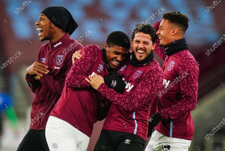 Substitutes Angelo Ogbonna of West Ham United, Ben Johnson of West Ham United, Pablo Fornals of West Ham United and Frederik Alves of West Ham United have a laugh during the warm up