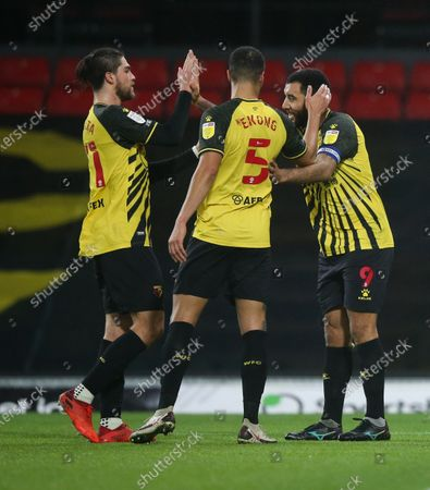 Troy Deeney of Watford scores a goal from the penalty spot and celebrates with William Troost-Ekong of Watford (5) & Francisco Sierralta of Watford