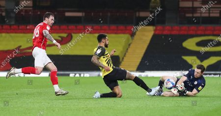 Andre Gray of Watford misses a one on one goal  with Jack Walton goalkeeper of Barnsley who saves