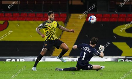 Stock Photo of Andre Gray of Watford misses a one on one  with Jack Walton goalkeeper of Barnsley as  he chips wide