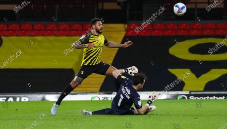 Andre Gray of Watford misses a one on one  with Jack Walton goalkeeper of Barnsley as  he chips wide