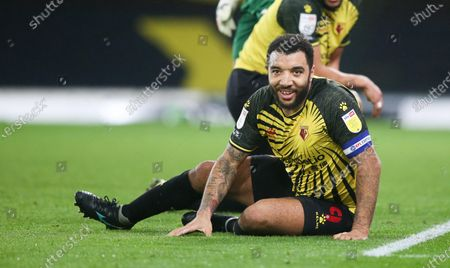Troy Deeney of Watford protests to the assistant referee (linesman) before giving him a smile & a thumbs up