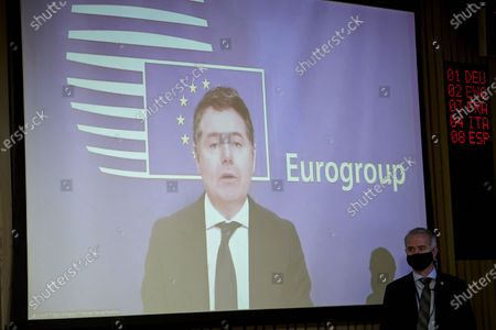Photo taken on Jan. 18, 2021 in Brussels, Belgium shows Paschal Donohoe (on the screen), president of Eurogroup, speaking at an online press conference after a Eurogroup ministerial meeting. The European Union (EU) plans to start raising and allocating in the next few months the main part of the 750-billion-euro (906-billion-U.S.-dollar) recovery fund, designed to bail out the bloc's economies hard hit by the COVID-19 pandemic, EU Commissioner for Economy Paolo Gentiloni said Monday.