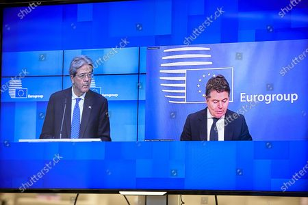 Photo taken on Jan. 18, 2021 shows Paolo Gentiloni (L), European Commissioner for Economy, and President of Eurogroup Paschal Donohoe, co-hosting an online press conference after a Eurogroup ministerial meeting, in Brussels, Belgium. The European Union (EU) plans to start raising and allocating in the next few months the main part of the 750-billion-euro (906-billion-U.S.-dollar) recovery fund, designed to bail out the bloc's economies hard hit by the COVID-19 pandemic, EU Commissioner for Economy Paolo Gentiloni said Monday.