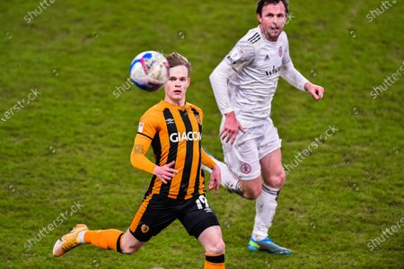 Keane Lewis-Potter of Hull City and Mark Hughes of Accrington Stanley