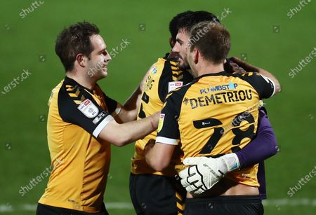 Goalkeeper Tom King of Newport County celebrates scoring his sides first goal.