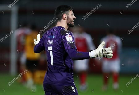 Tom King of Newport County smiles during the first half after scoring the opening goal.