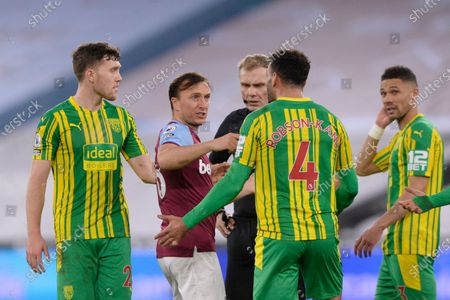 Mark Noble of West Ham United and Hal Robson-Kanu of West Brom during Premier League match between West Ham United and West Brom at The London Stadium in London.