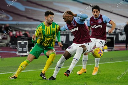 Angelo Ogbonna of West Ham United and Hal Robson-Kanu of West Brom in action during Premier League match between West Ham United and West Brom at The London Stadium in London.