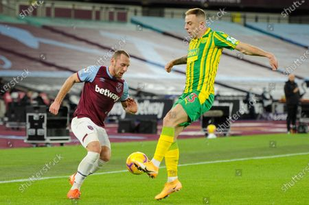 Vladimir Coufal of West Ham United and /wb/13/ of West Brom in action during Premier League match between West Ham United and West Brom at The London Stadium in London.