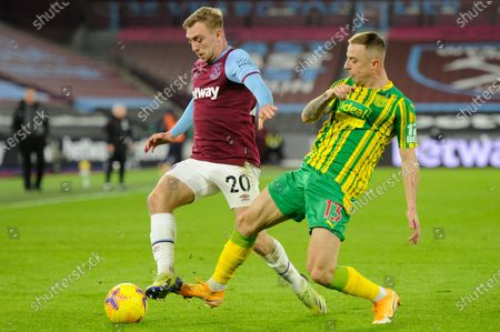 Jarrod Bowen of West Ham United and Kamil Grosicki of West Brom in action during Premier League match between West Ham United and West Brom at The London Stadium in London.