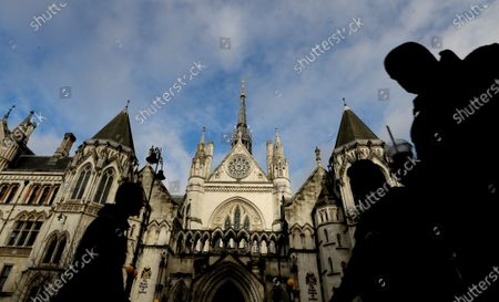 Stock Image of Pedestrians pass by the Royal Courts Of Justice, in London, . Meghan, The Duchess of Sussex will ask a High Court judge to rule in her favour in her privacy action against the Mail on Sunday over the publication of a handwritten letter to her estranged father. The case will be heard remotely due to the pandemic