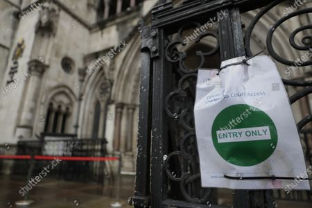 Sign outside The Royal Courts Of Justice, in London, . Meghan, the Duchess of Sussex will ask a High Court judge to rule in her favour in her privacy action against the Mail on Sunday over the publication of a handwritten letter to her estranged father. The case will be heard remotely due to the pandemic