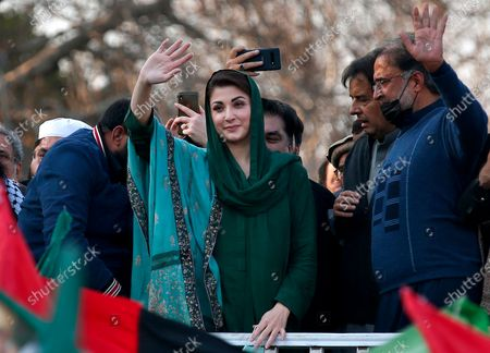 Maryam Nawaz Sharif, center, a leader of the Pakistan Democratic Movement, an alliance of opposition parties, waves to supporters during a rally outside the head office of the Election Commission of Pakistan, in Islamabad, Pakistan, . They want a decision on a foreign-funding case against the ruling party