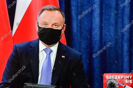 Stock Photo of Polish President Andrzej Duda is seen displayed on a TV screen during a question and answer session broadcast from the Presidential Palace in Warsaw, Poland, 19 January 2021. The meeting concerns about the vaccination against the coronavirus disease (COVID-19).