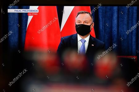 Stock Picture of Polish President Andrzej Duda is seen displayed on a TV screen during a question and answer session broadcast from the Presidential Palace in Warsaw, Poland, 19 January 2021. The meeting concerns about the vaccination against the coronavirus disease (COVID-19).