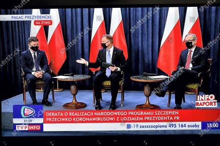 (L-R) Head of the Prime Minister's Office, the head of the vaccination strategy Michal Dworczyk, Polish President Andrzej Duda and Health Minister Adam Niedzielski are seen displayed on a TV screen during a question and answer session broadcast from the Presidential Palace in Warsaw, Poland, 19 January 2021. The meeting concerns about the vaccination against the coronavirus disease (COVID-19).
