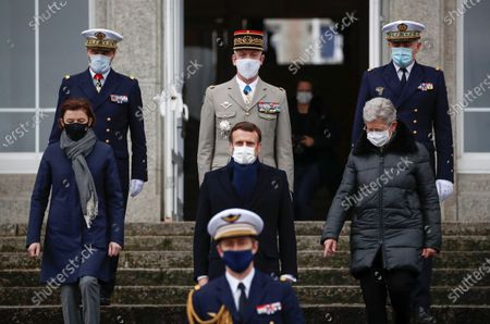 French President Emmanuel Macron (C), Minister of the Armed Forces Florence Parly (L, front) and Junior Minister for Defence Genevieve Darrieussecq (R, front) arrive to review troops during a military ceremony before Macron delivers his new year wishes in Brest, France, 19 January 2021.