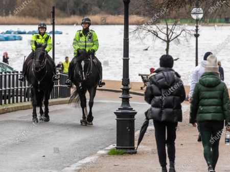 Editorial photo of Police keep up patrols in Hyde Park in London as Home Secretary warned that there will be tougher enforcement of covid-19 rules, London, UK - 19 Jan 2021