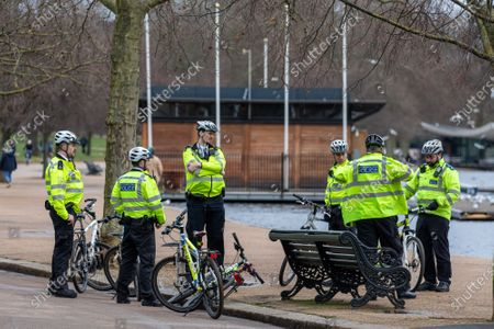 Police on bikes take a rest next to a bench in Hyde Park. Police keep up patrols in Hyde Park in London as Home Secretary Priti Patel warned that there will be tougher enforcement of Covid-19 rules. Today Health Secretary Matt Hancock announced that he will self-isolates after an alert on his Covid-19 app while cases continue to spread through the UK. Last week, Foreign Secretary Dominic Rabb said that lockdown could be lifted in March but with tier systems in place as total Covid-19 deaths reach over 88,000 this weekend.