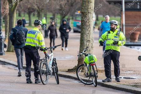 Stock Picture of Police keep up patrols in Hyde Park in London as Home Secretary Priti Patel warned that there will be tougher enforcement of Covid-19 rules. Today Health Secretary Matt Hancock announced that he will self-isolates after an alert on his Covid-19 app while cases continue to spread through the UK. Last week, Foreign Secretary Dominic Rabb said that lockdown could be lifted in March but with tier systems in place as total Covid-19 deaths reach over 88,000 this weekend.