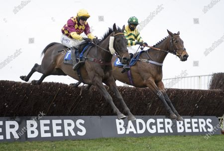 Favori de Sivola (David Noonan, left) jumps the last fence and beats Findusatgorcombe (Bryony Frost) in the 3m 1f handicap chaseWincanton 21.1.21 Pic: Edward Whitaker