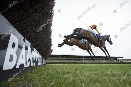 Favori de Sivola (David Noonan, near) jumps the last fence and beats Findusatgorcombe (Bryony Frost) in the 3m 1f handicap chaseWincanton 21.1.21 Pic: Edward Whitaker