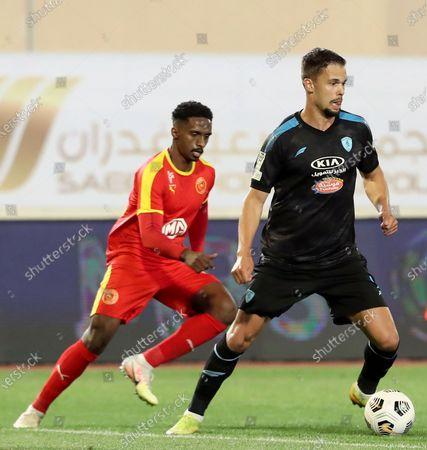 Al-Qadisiyah's player Khalifah Aldawsari (L) in action against Al-Fateh's Mitchell Te Vrede (R) during the Saudi Professional League soccer match between Al-Qadisiyah and Al-Fateh at Prince Saud Bin Jalawy Stadium, in Dammam, Saudi Arabia, 19 January 2021.