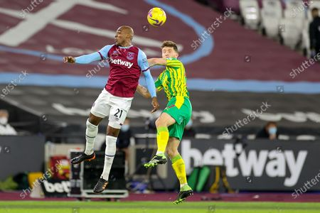 Angelo Ogbonna (21) of West Ham United and Dara O'Shea (27) of West Bromwich Albion clash in the air during the Premier League match between West Ham United and West Bromwich Albion at the London Stadium, London