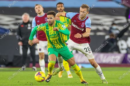 Hal Robson-Kanu (4) of West Bromwich Albion tries to get away from Tomas Soucek (28) of West Ham United during the Premier League match between West Ham United and West Bromwich Albion at the London Stadium, London
