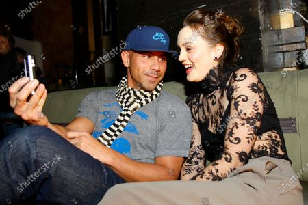 Leighton Meester and club owner Billy Dec backstage before Leighton performs at The Underground on January 1, 2010 in Chicago, IL.