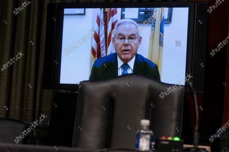 Sen. Bob Menendez, D-N.J., speaks via teleconference during a Senate Finance Committee hearing to examine the expected nomination of Janet Yellen to be Secretary of the Treasury on Capitol Hill in Washington