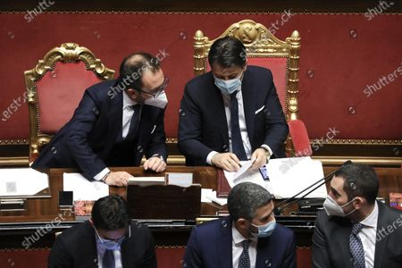 Giuseppe Conte, Italy's prime minister (R) speaks with Alfonso Bonafede, Italy's justice minister, during a debate in the Senate in Rome, Italy, 19 January 2021. Following the resignation of two ministers in Italian Prime Minister Conte's coalition government over a dispute on spending of EU funds during the pandemic, the Italian government is on the verge of another crisis.