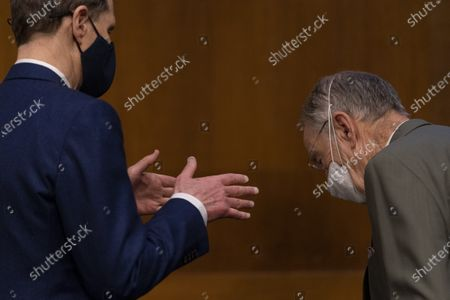 Ranking Member Ron Wyden, D-Ore., left, and Chairman Sen. Chuck Grassley, R-Iowa, right, speak together before the start of a Senate Finance Committee hearing to examine the expected nomination of Janet Yellen to be Secretary of the Treasury on Capitol Hill in Washington,.