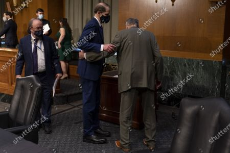 Ranking Member Ron Wyden, D-Ore., center left, and Chairman Sen. Chuck Grassley, R-Iowa, right, speak together before the start of a Senate Finance Committee hearing to examine the expected nomination of Janet Yellen to be Secretary of the Treasury on Capitol Hill in Washington,.