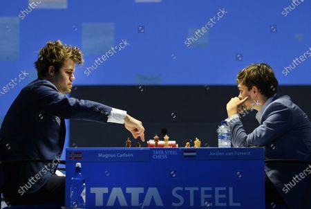 Dutch chess grandmaster Jorden van Foreest plays Norwegian World Champion Magnus Carlsen (L) in the fourth round of the international TataSteel Chess Tournament 2021, in Wijk aan Zee, the Netherlands, 19 January 2021.