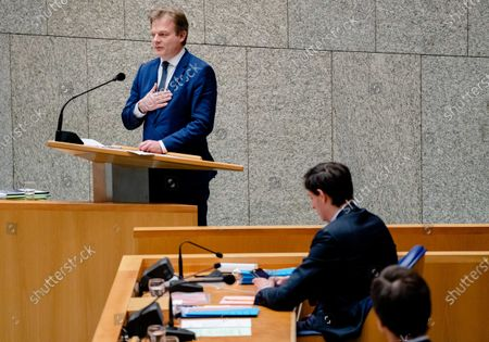 Stock Image of Pieter Omtzigt (CDA), outgoing Minister Wopke Hoekstra of Finance (CDA) and outgoing Prime Minister Mark Rutte in the House of Representatives during a debate about the benefits affair. The cabinet has resigned as a result of the report of the parliamentary committee on the affair. In The Hague, the Netherlands, 19 January 2021.