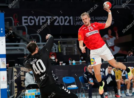 Denmark's Johan P. Hansen (R) in action against Argentina goalkeeper Leonel Carlos Sergio Maciel (L) during the match between Denmark and Argentina at the 27th Men's Handball World Championship in Cairo, Egypt, 19 January 2021.