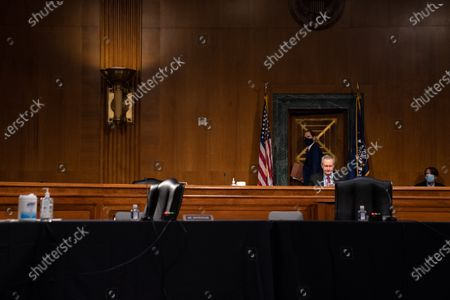 United States Senator Ron Wyden (Democrat of Oregon), Ranking Member, US Senate Committee on Finance, looks back as he exits from a Senate Finance Committee hearing for Janet L. Yellen, of California, President-elect Joe Biden's nominee for Treasury Secretary, in Washington DC, January 19th, 2021.