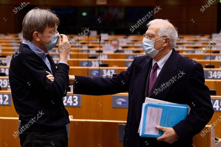 EU commisioner for Foreign Affairs and Security Policy Josep Borrell (R) talks with Member of the European Parliament Guy Verhofstadt during a plenary session on EU global strategy on Covid-19 vaccinations at the EU parliament in Brussels, Belgium, 19 January 2021.