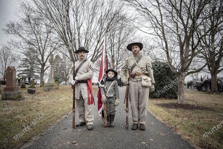 Commemorating Confederate generals Robert E. Lee and Stonewall Jackson. People walking down Main Street and gathering at the Stonewall Jackson memorial. Many participants are dressed in Confederate uniforms from the civil war. Chris, Gunner and Sean