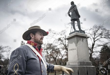 Stock Image of Commemorating Confederate generals Robert E. Lee and Stonewall Jackson. People walking down Main Street and gathering at the Stonewall Jackson memorial. Many participants are dressed in Confederate uniforms from the civil war. Brandon Dorsey at General Jackson's statue. Dorsey does not rule out a new civil war in the coming years