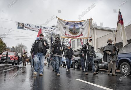 Stock Photo of Commemorating Confederate generals Robert E. Lee and Stonewall Jackson. People walking down Main Street and gathering at the Stonewall Jackson memorial. Many participants are dressed in Confederate uniforms from the civil war