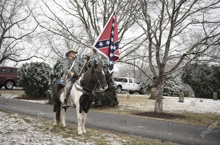 Commemorating Confederate generals Robert E. Lee and Stonewall Jackson. People walking down Main Street and gathering at the Stonewall Jackson memorial. Many participants are dressed in Confederate uniforms from the civil war