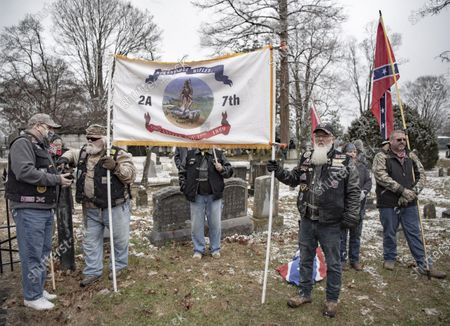 Stock Picture of Commemorating Confederate generals Robert E. Lee and Stonewall Jackson. People walking down Main Street and gathering at the Stonewall Jackson memorial. Many participants are dressed in Confederate uniforms from the civil war